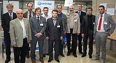 A group of people at the Hartridge stand at Delphi